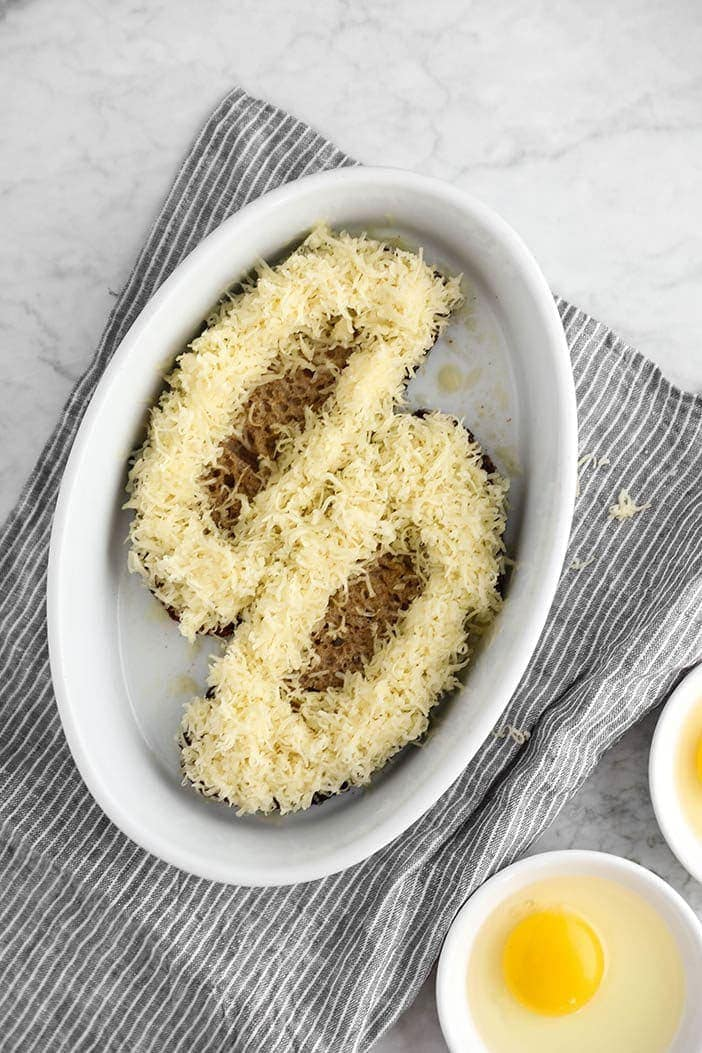 Create nests with grated cheese as a space for the eggs