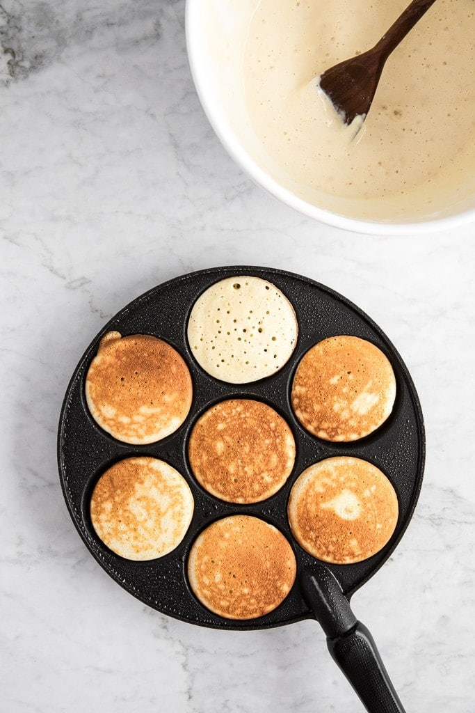Pancake pan with pancakes and batter