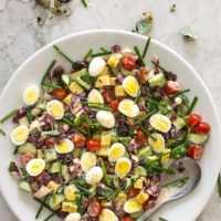Chopped salad with quail eggs and creme fraiche