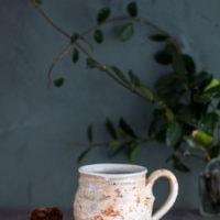 Hand-Thrown Large Textured Mug in white and burnt orange