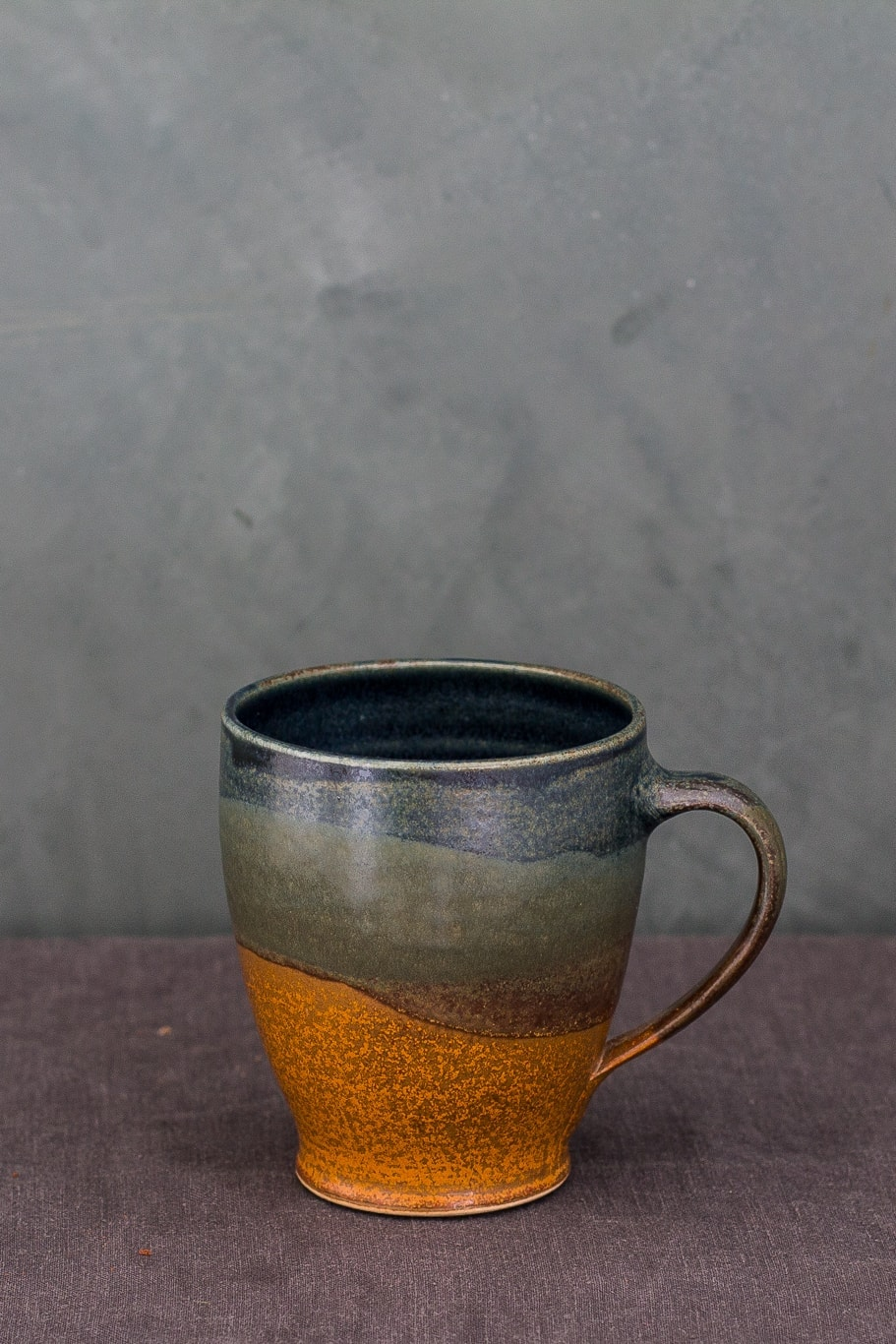 Rust/sage/indigo hand-thrown ceramic cup