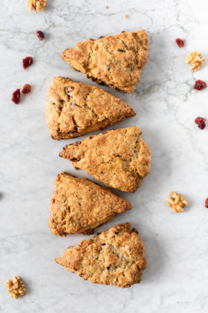 five cranberry walnut scones on a marble surface