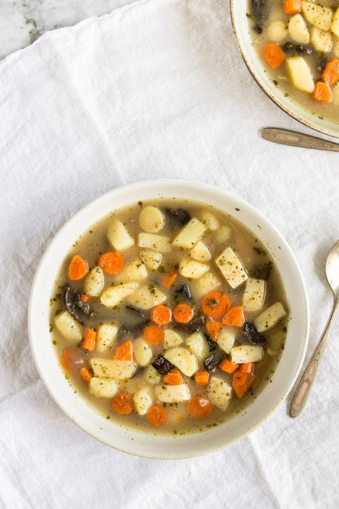 Classic Czech countryside soup made with potatoes, root vegetables and dried porcini mushrooms. Comforting and perfect for cold winter days.