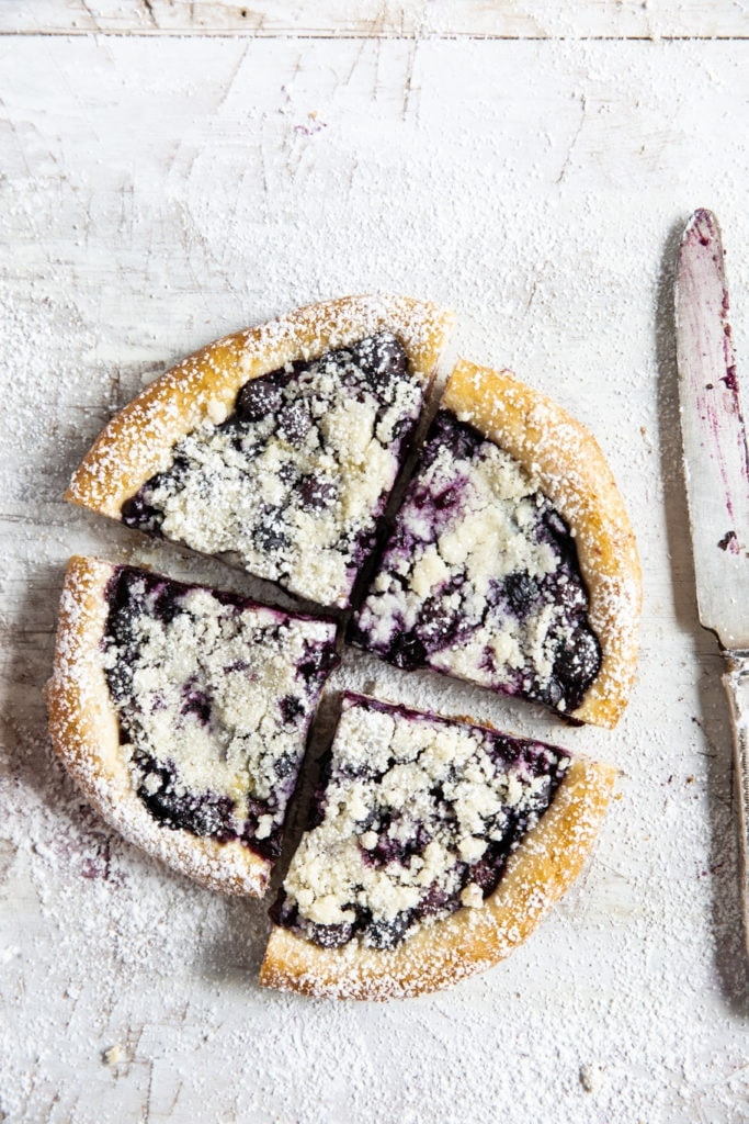 four slices of blueberry kolach/kolac with a knife
