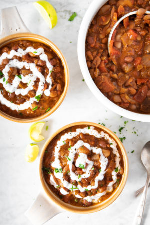 two bowls and a pot of vegan heirloom-bean chili