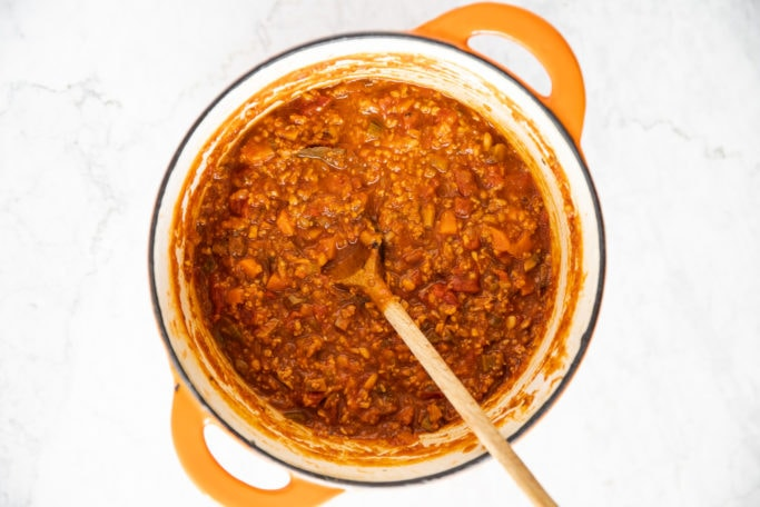 Dutch oven pot with Bolognese pasta sauce