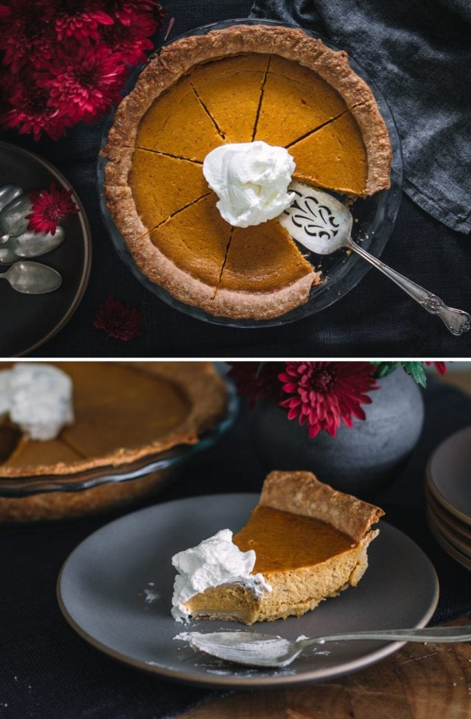 Slice of pumpkin pie with spelt crust, topped with whipped cream