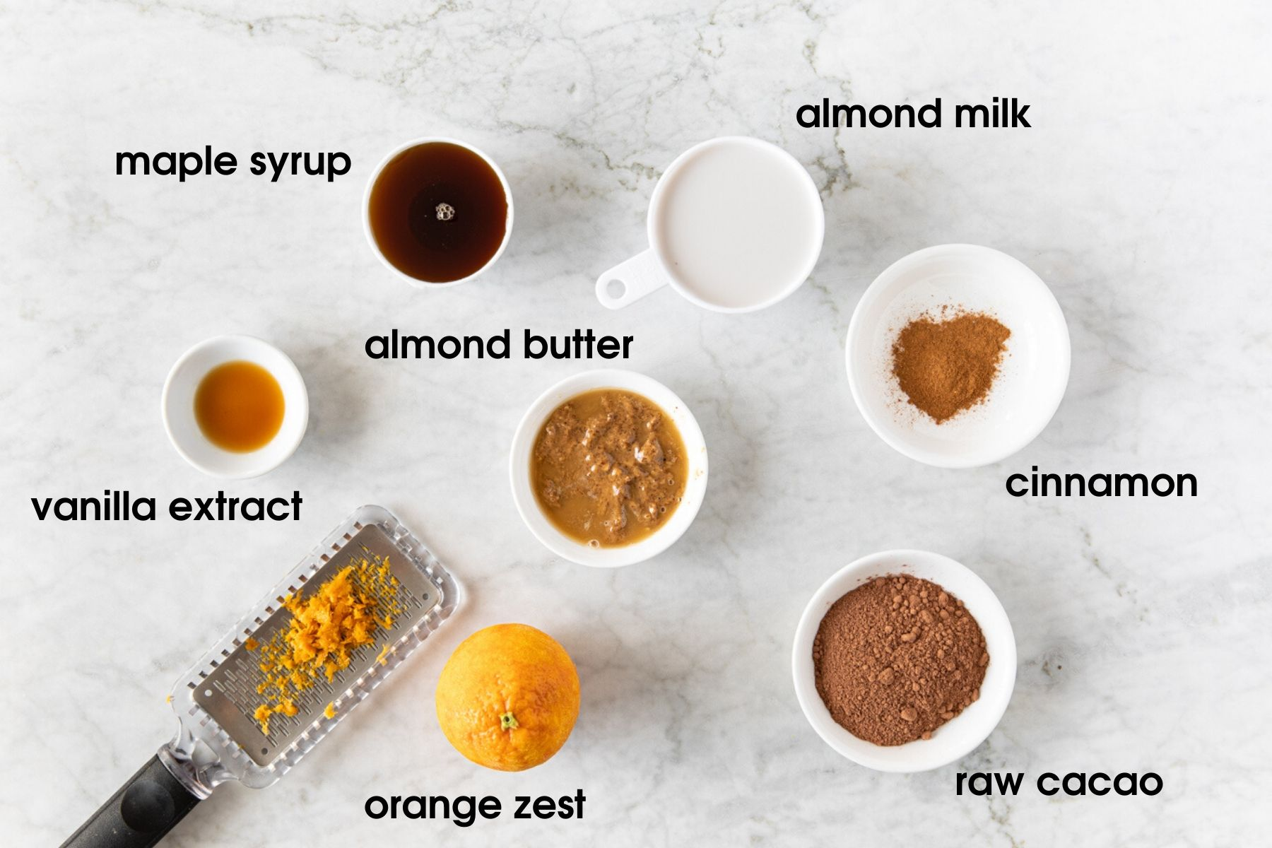 Ingredients needed to for sweet potato chocolate pudding: maple syrup, almond milk, almond butter, cinnamon, raw cacao, orange zest, vanilla extract