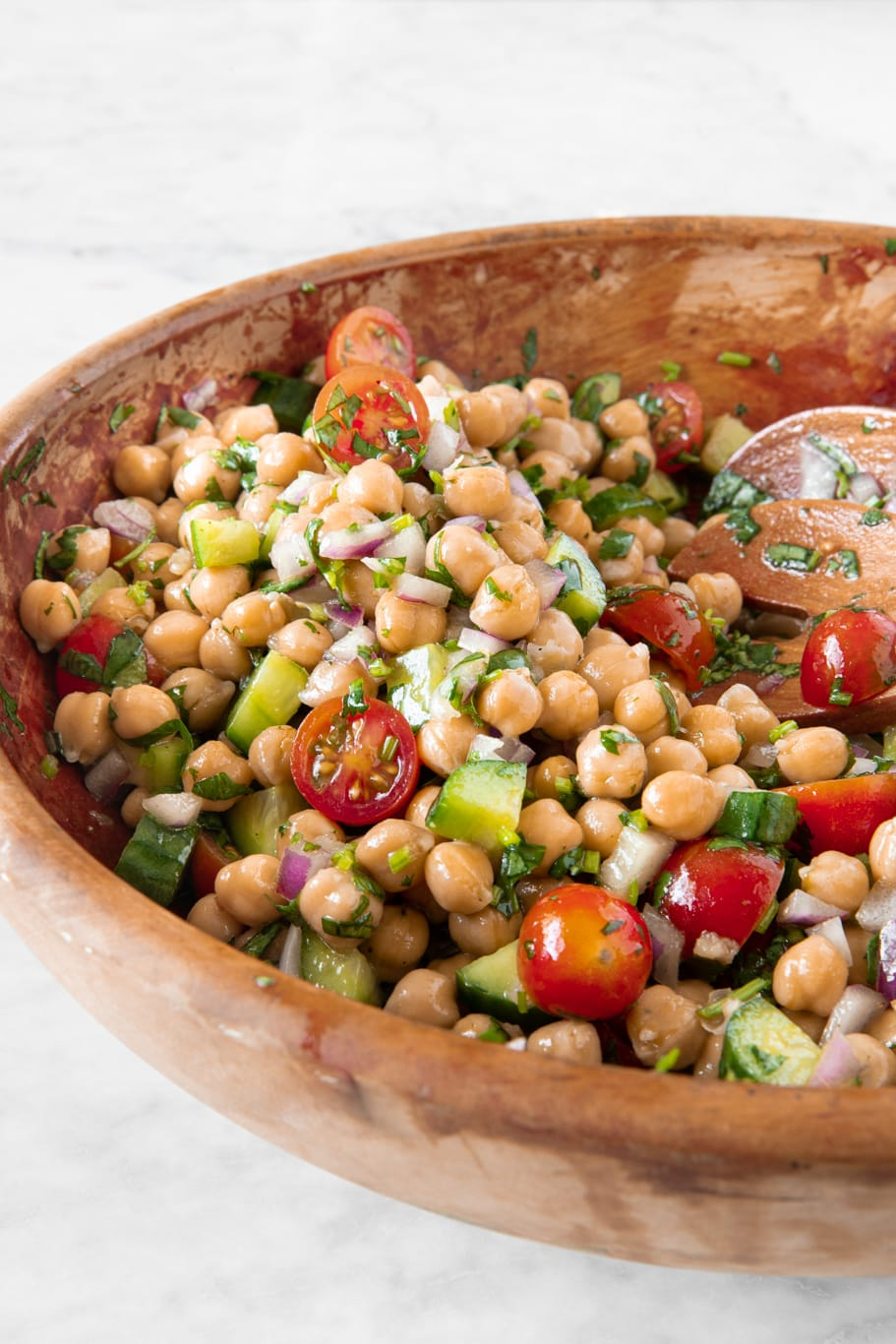 Wooden bowl with Easy Chickpea Salad With Tomatoes and Cucumbers