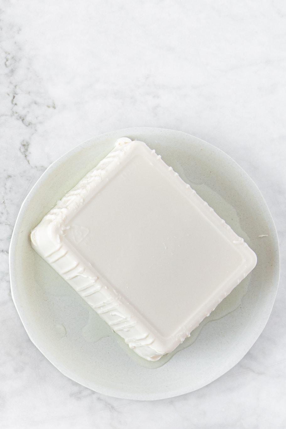 plate of a block of silken tofu