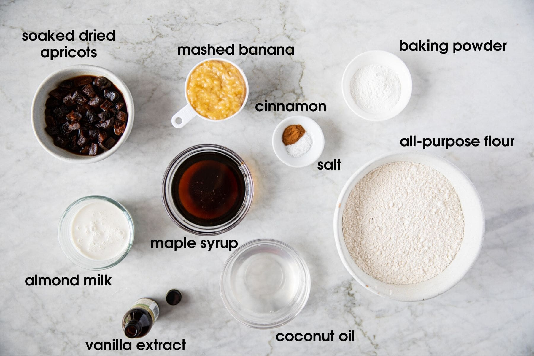 Ingredients for Vegan Banana Apricot Muffins: dried apricots, mashed banana, baking powder, cinnamon, salt, all-purpose flour, coconut oil, maple syrup, vanilla extract, almond milk
