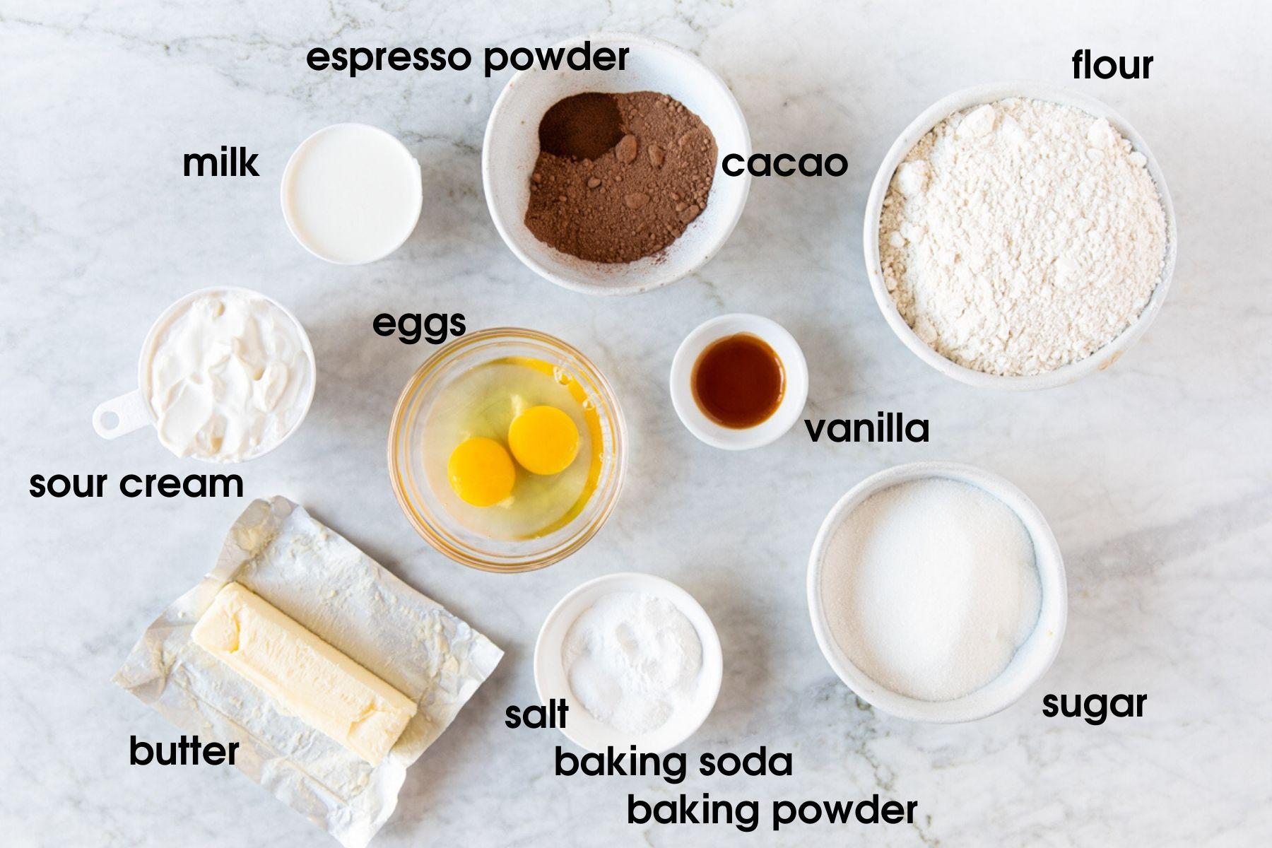 Vanilla Chocolate Marble Bundt Cake ingredients: milk, espresso powder, cacao, flour, vanilla extract, sugar, baking powder, baking soda, salt, eggs, butter, and sour cream