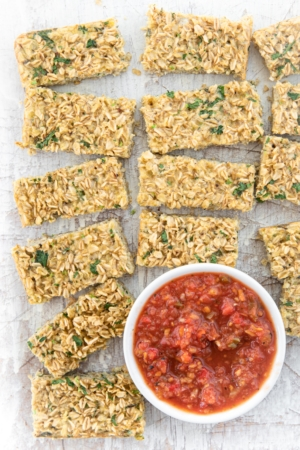 slices of savory oatmeal bas with tomato salsa