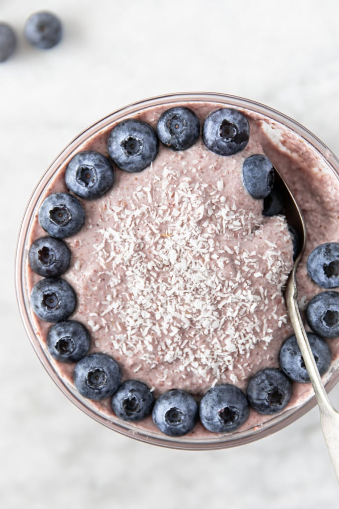 bowl of vegan raw buckwheat groats porridge from very good cook blog, topped with fresh fruit and shredded coconut