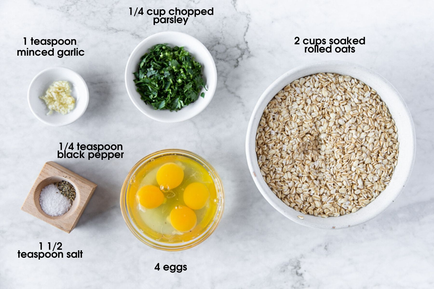 ingredients to make easy savory oatmeal bars using eggs, parsley, garlic, salt, black pepper and soaked oats.