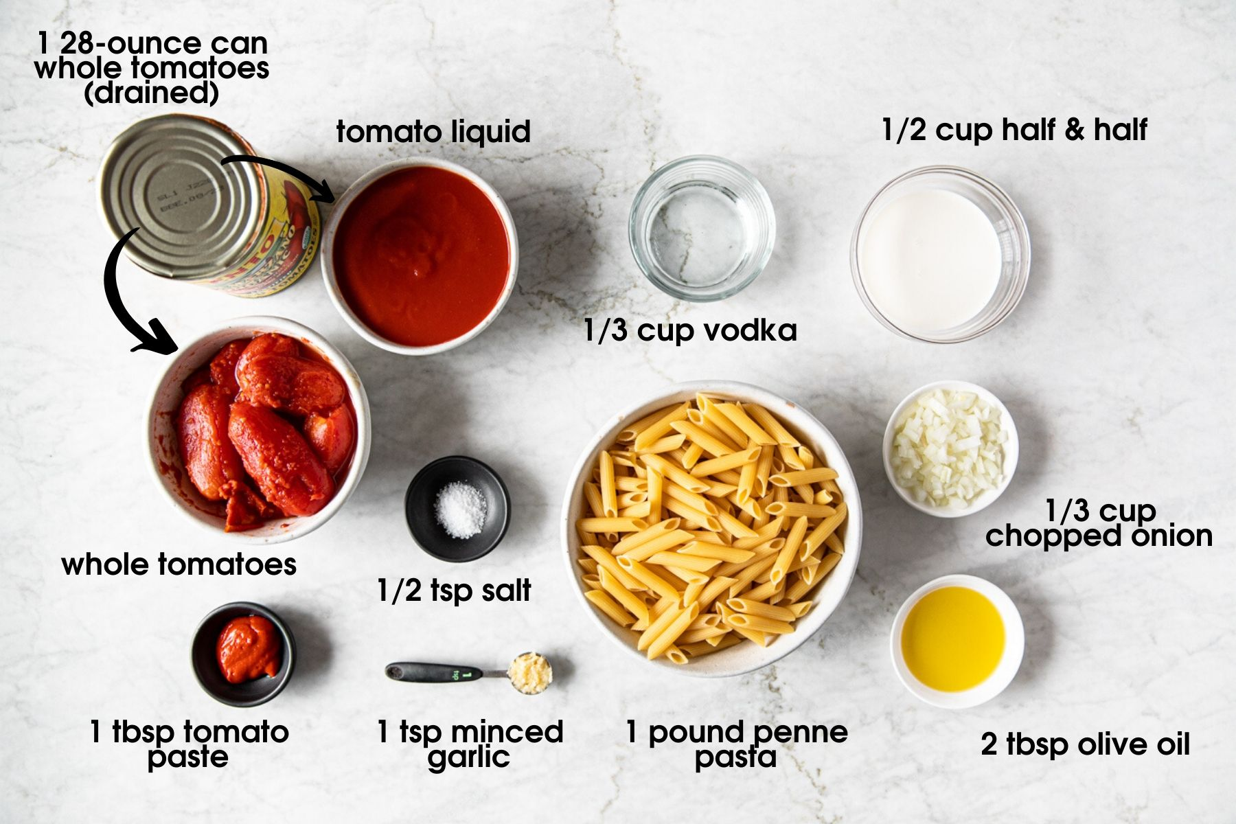 Easy Creamy Penne Alla Vodka Recipe Ingredients, including whole tomatoes, vodka, half & half, onion, olive oil, tomato paste, salt, minced garlic, and penne pasta