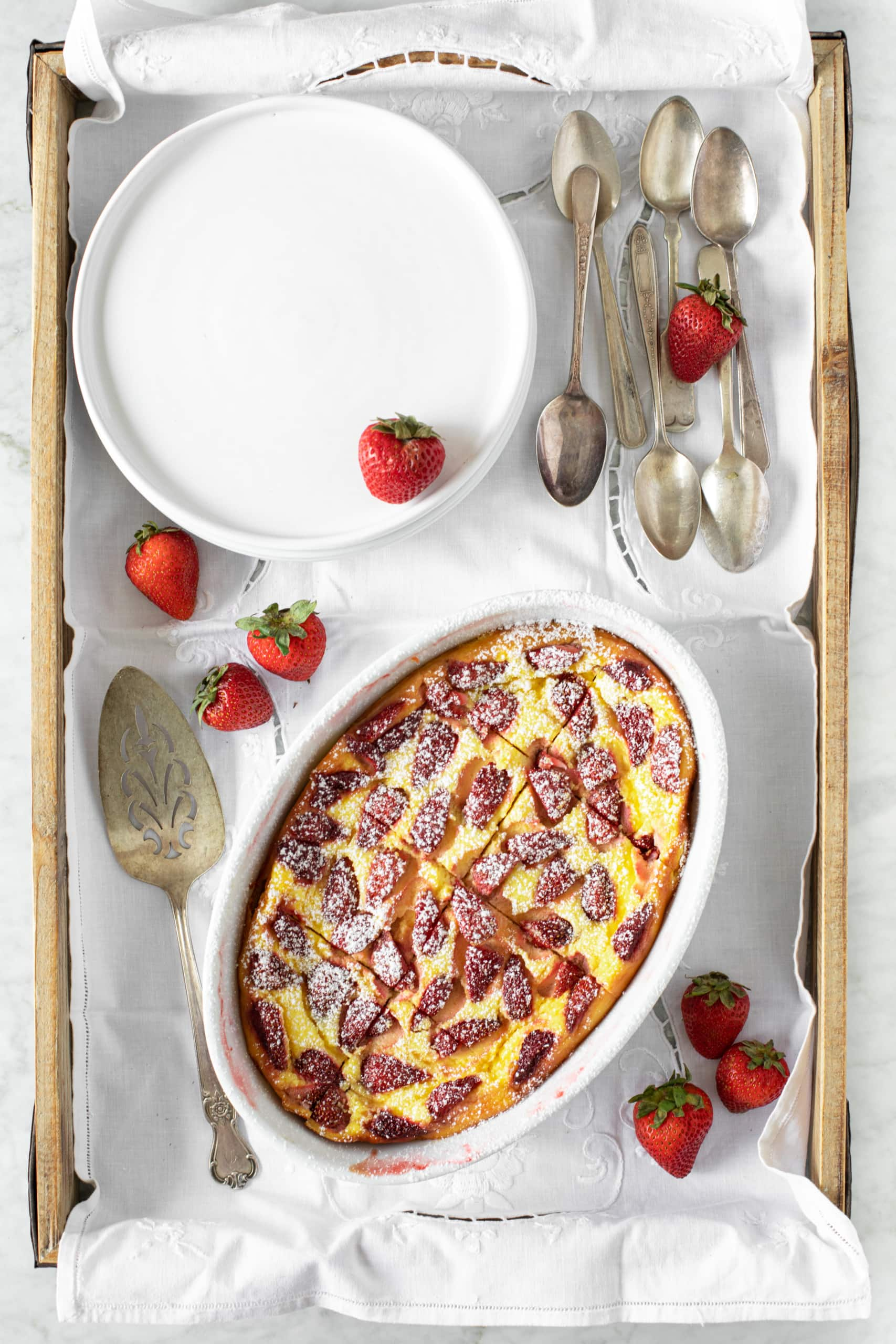 Raspberry Ricotta Soufflé recipe made using strawberries, with sprinkled sugar and fresh whole strawberries | verygoodcook.com