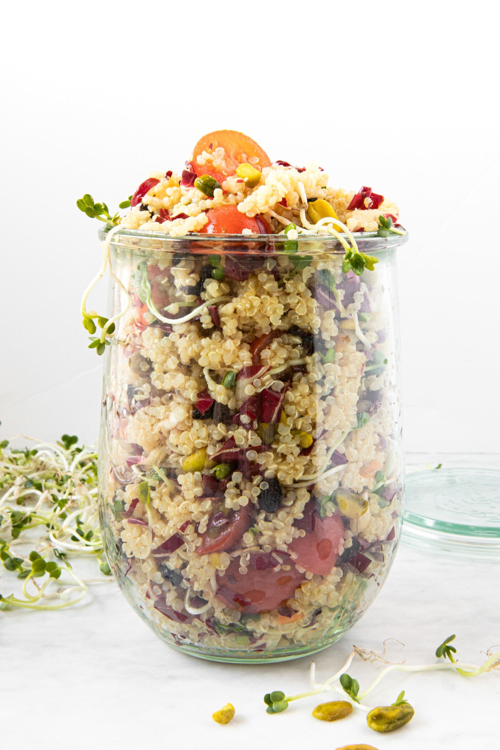 Glass serving dish with Quinoa Salad With Cherry Tomatoes, Radicchio, and Pistachios from verygoodcook.com