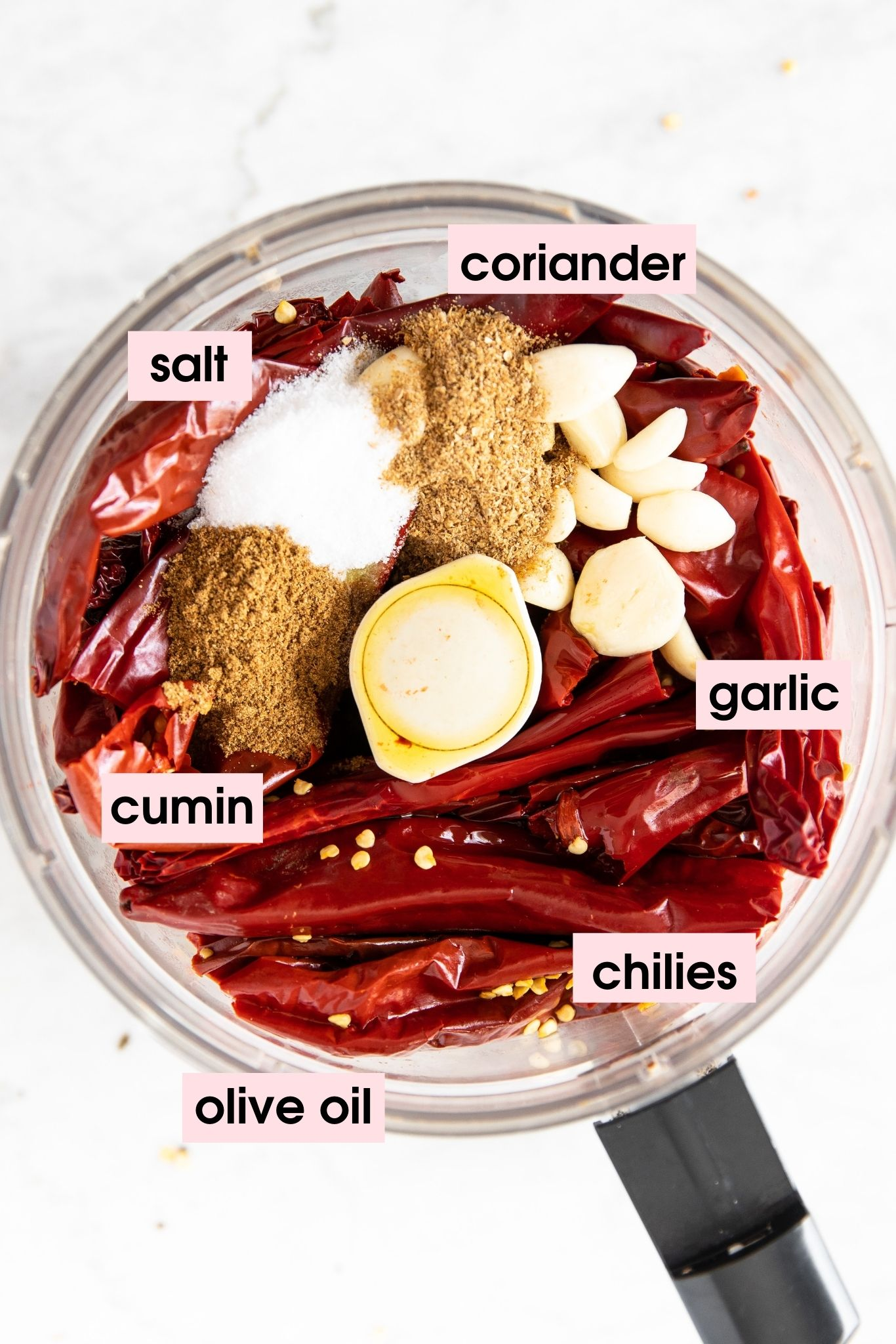 Photo showing how to make harissa paste in a food processor using dried chillies, garlic, cumin, coriander and olive oil| from verygoodcook.com