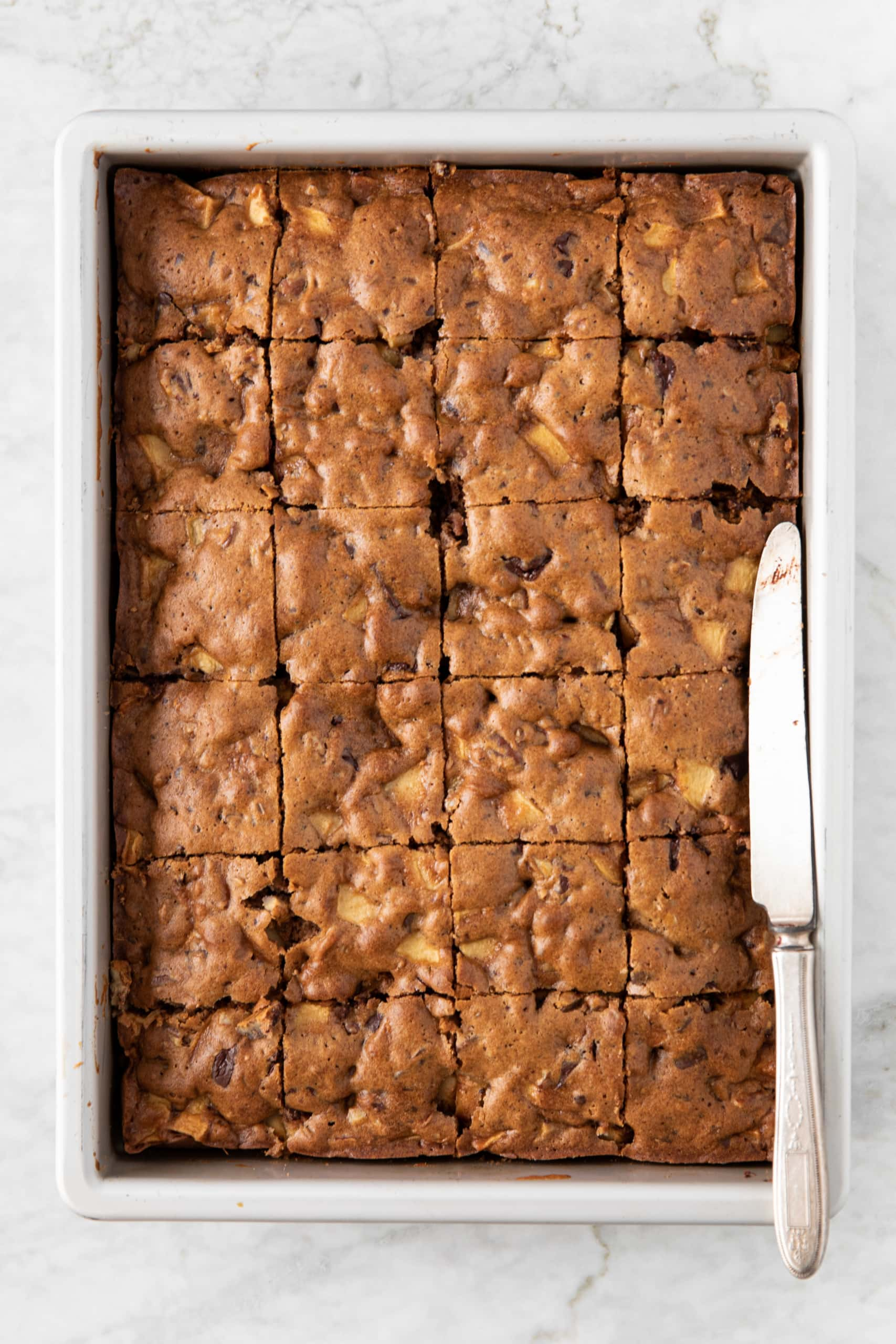 Baking pan with Apple Pecan Chocolate Coffee Cake, cut into slices | from verygoodcook.com