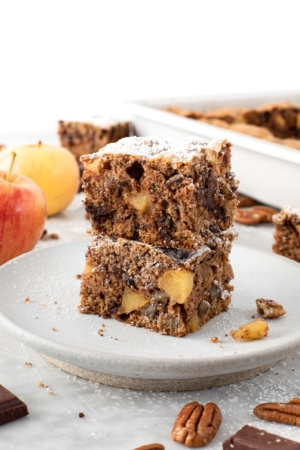 Slices of Apple Pecan Chocolate Coffee Cake on a plate