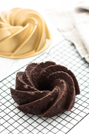 Chocolate Banana Paleo Cake made using a pinwheel bundt pan- from verygoodcook.com